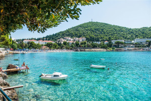 Lapad Bay Main Beach Is The Of Peninsula And Surrounded By Lush Plants Trees With Pretty Walkways Smaller Coves Beaches