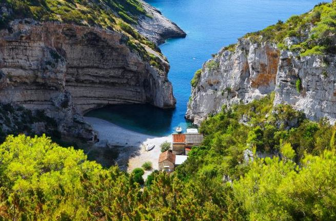 Cliffs tower over the beach at Stiniva - photo GETTY